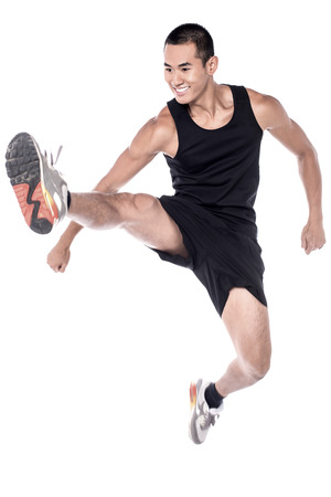clenching fists: Young man doing stretching exercises over white Stock Photo