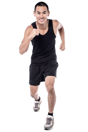 athletic wear: Young man jogging and listening to music