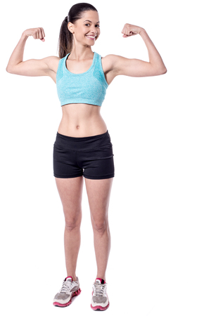 underarms: Young fit woman showing biceps