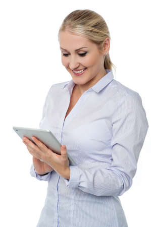 looking into: Young woman looking into tablet device Stock Photo