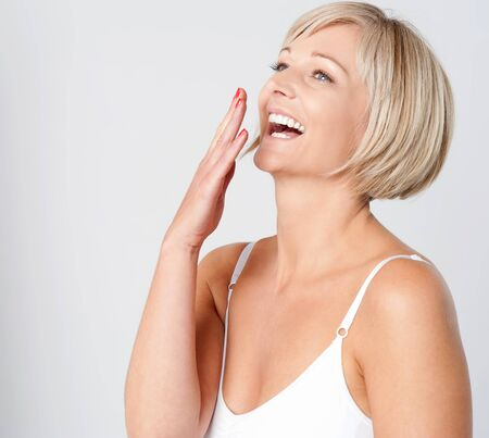 inner wear: Pretty caucasian lady laughing out loud Stock Photo