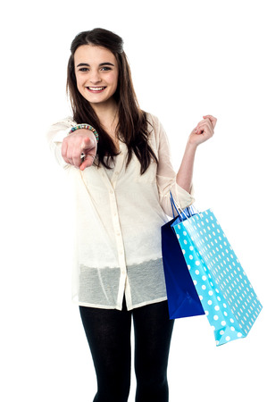 Charming teenager posing with shopping bags photo
