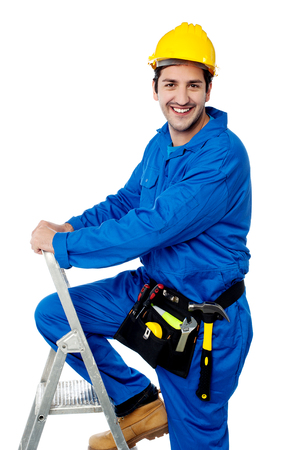 step ladder: Young mechanic on the step ladder Stock Photo