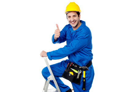 yup: Young construction worker showing thumbs up