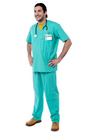 hands on waist: Smiling male doctor with hands on waist