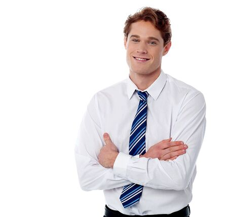 folded arms: Handsome employee posing with folded arms