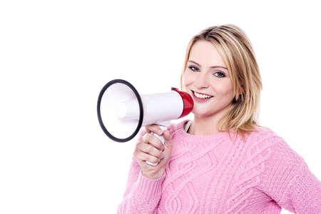 making an announcement: Woman making announcement with megaphone over white Stock Photo