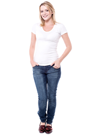 hands on pockets: Full length image of young woman with hands in pockets