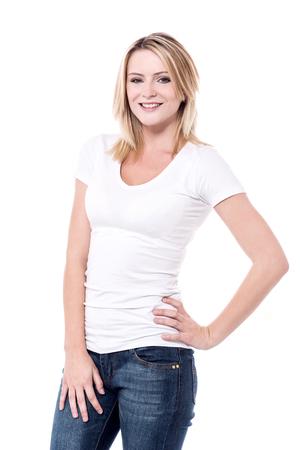 stylishly: Beautiful young woman posing to camera stylishly