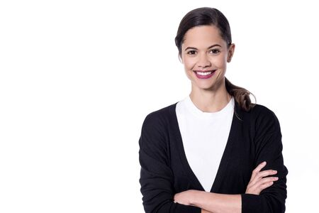 folded arms: Happy young woman posing with folded arms Stock Photo