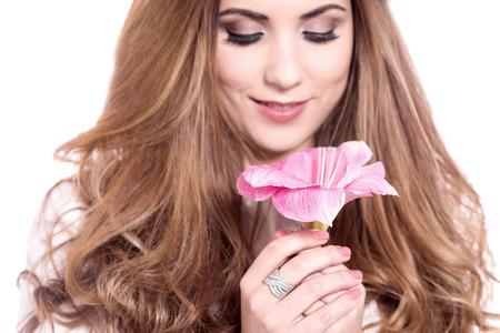 stargazer lily: Gorgeous pretty woman holding stargazer lily Stock Photo