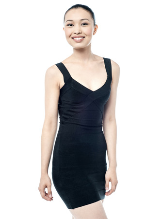 sleeveless dress: Pretty woman in black sleeveless dress Stock Photo
