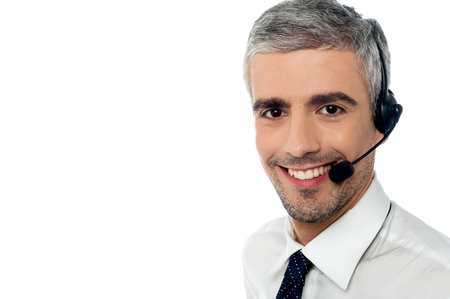 experienced operator: Young executive attending customers query