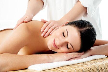 Therapist giving massage to woman photo