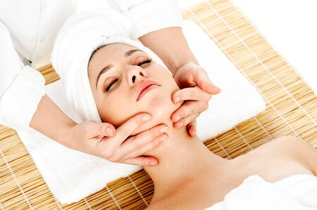 Lady getting face massage at day spa photo