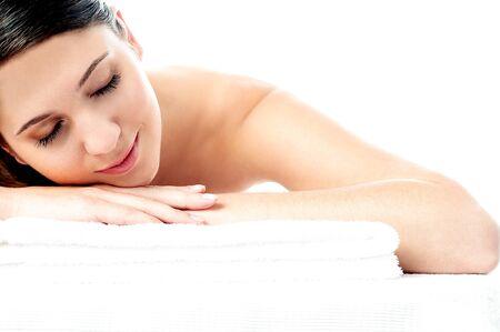 Pretty woman enjoying her spa treatment photo