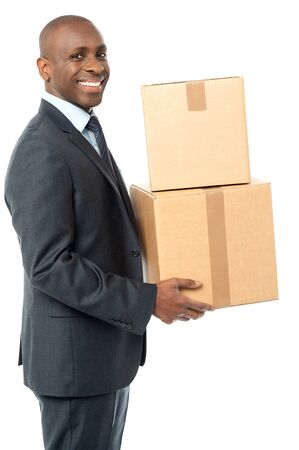 cardboard boxes: Businessman carrying cardboard boxes