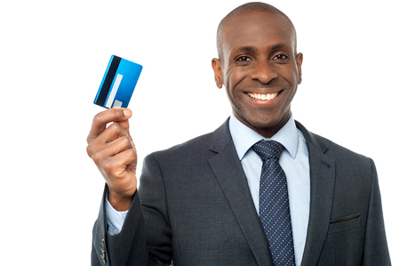 swap: Company boss showing credit card Stock Photo
