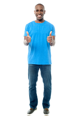 yup: Cheerful guy showing double thumbs up Stock Photo