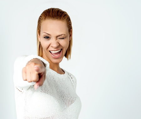 non verbal: Smart winking lady pointing you out