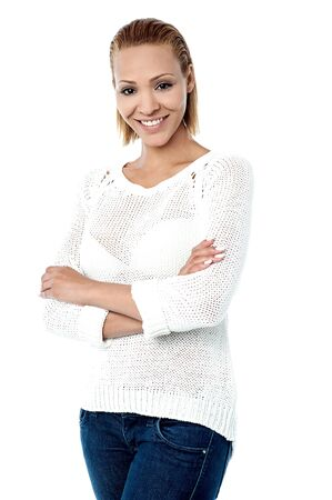 smartly: Young lady posing smartly over white