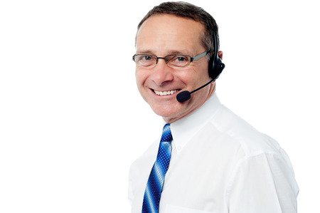 experienced operator: smiling customer support executive posing over white