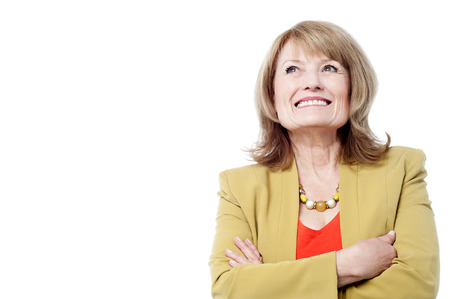 fond: Senior woman folding arms and fond memories