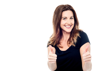 Cheerful lady showing thumbs up sign towards camera