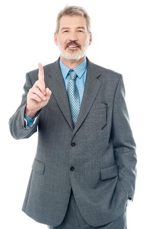 index finger: Aged boss showing index finger over white