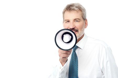 loudhailer: Senior business executive talking on a loudhailer