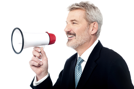 loudhailer: Side pose of senior businessman holding loudhailer