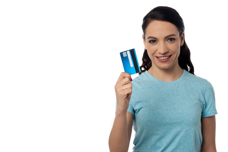 displaying: Pretty woman displaying her credit card over white