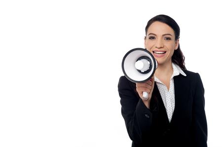 loudhailer: Portrait of a corporate woman with loudhailer