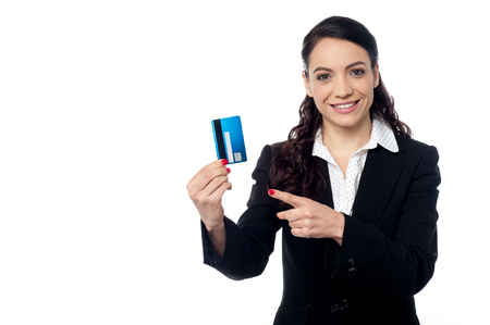 Pretty female entrepreneur showing her credit card Stock Photo