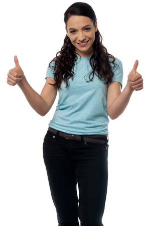 posing  agree: Portrait of a smiling woman with thumbs up gesture
