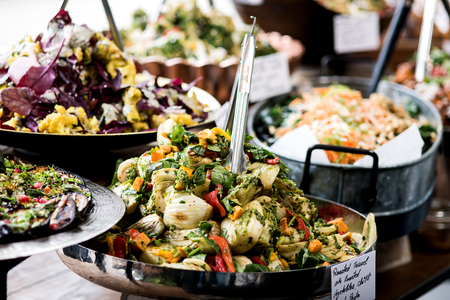 Cropped image of assorted salads in a buffet