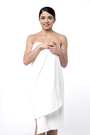 wrapped in a towel: Beautiful young woman wrapped in towel