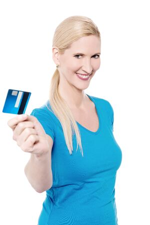 lending: Woman lending her plastic card to you against white