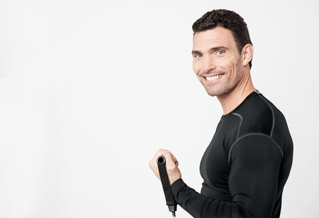 side pose: Side pose of a male exercising with stretching band Stock Photo