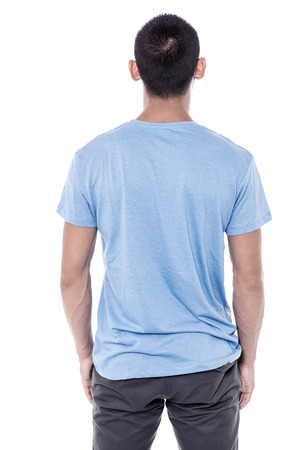 facing a wall: Back pose of young man facing the wall Stock Photo