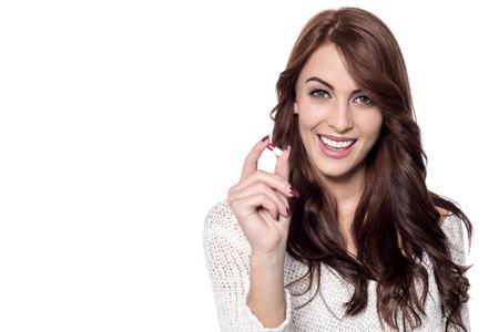 vitamin pill: Happy woman showing vitamin pill to camera Stock Photo