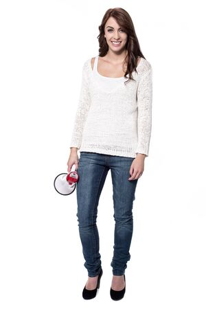 loudhailer: Woman holding loudhailer standing on white background
