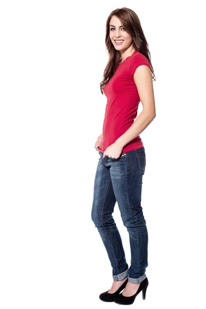 hands on pockets: Attractive woman posing with hands in pockets