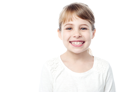 Sweet girl child with bright smile Imagens