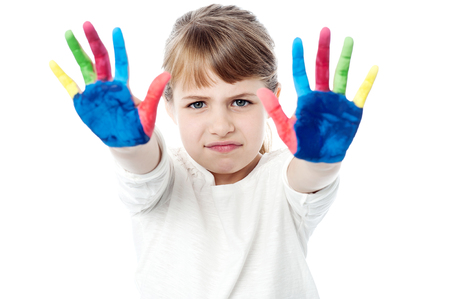 kids painted hands: Girl not happy with colors on palms