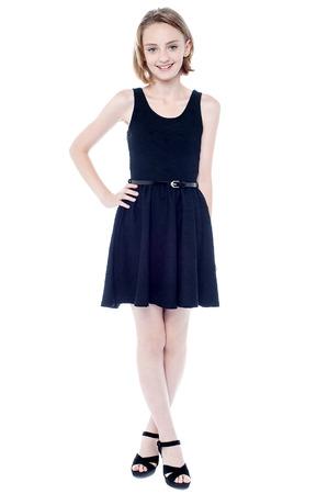 sleeveless dress: Beautiful girl in black sleeveless dress Stock Photo