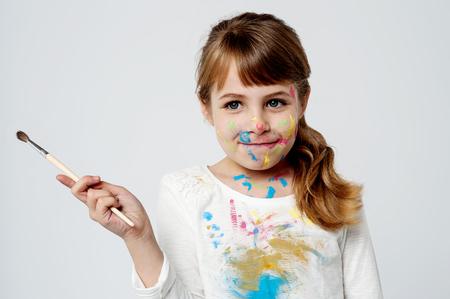 naughty girl: Naughty girl holding paint brush Stock Photo