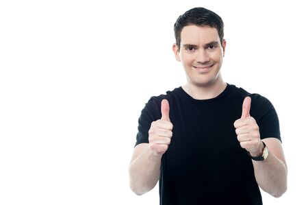 Casual guy showing double thumbs up