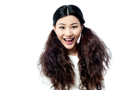 Cute girl bursting into laughter Reklamní fotografie