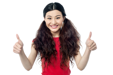 yup: Young girl showing double thumbs up Stock Photo
